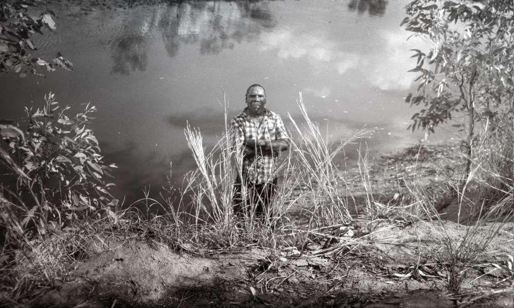 Neil Jupurrurla Cooke at the Catfish waterhole, near Lajamanu 2014. Photograph by Judith Crispin.