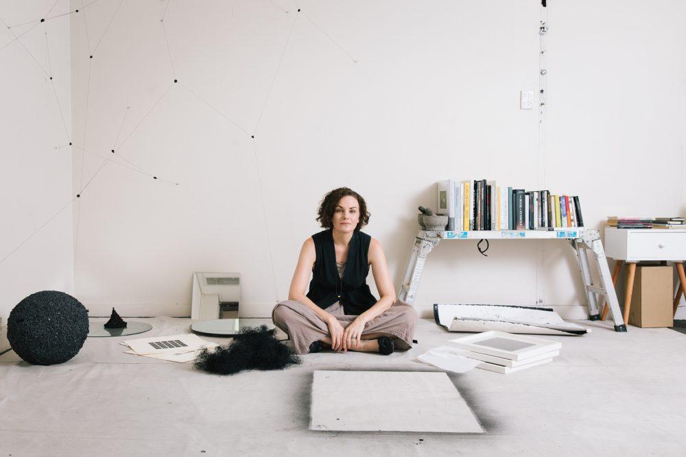 A photo of artist Emma Fielden in her studio