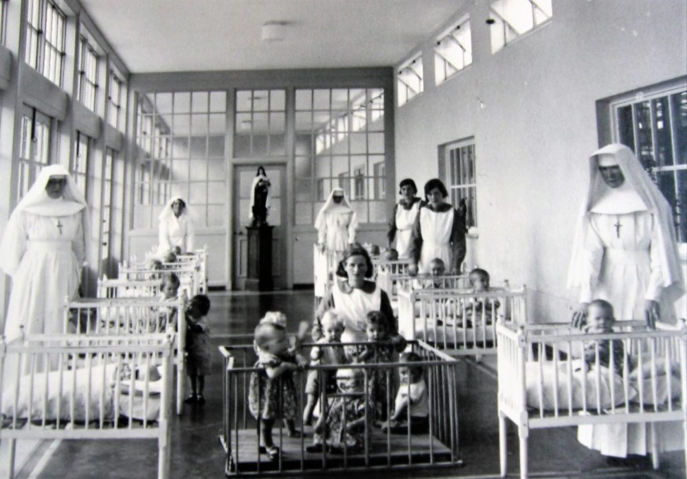 A picture of Catholic nuns, nurses and babies at a Mother and Babies Home in Ireland